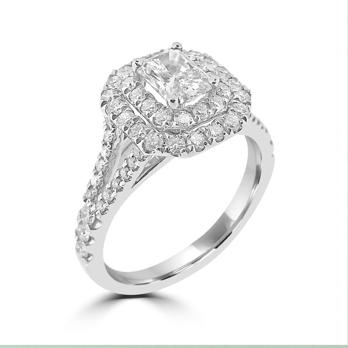 Cushion shaped double halo with a Radiant cut diamond at its centre and split diamond set shoulders in platinum