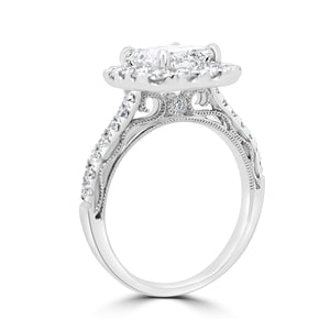 Emerald cut diamond solitaire with halo and diamond set shoulders in 18ct white gold
