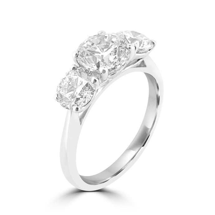 Three Stone Brilliant cut diamond platinum Ring