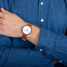 Load image into Gallery viewer, Obaku, black case, white dial and leather strap.