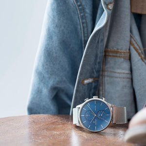 Obaku, blue dial, duel time and steel casing with mesh bracelet.