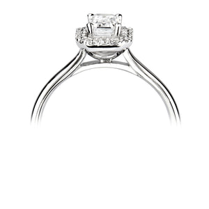 Emerald cut Diamond solitaire with Halo and Diamond set shoulders in Platinum