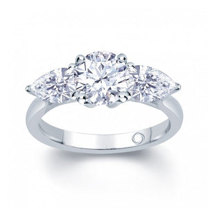 Platinum Three-Stone Round and Pear Cut Diamond Ring