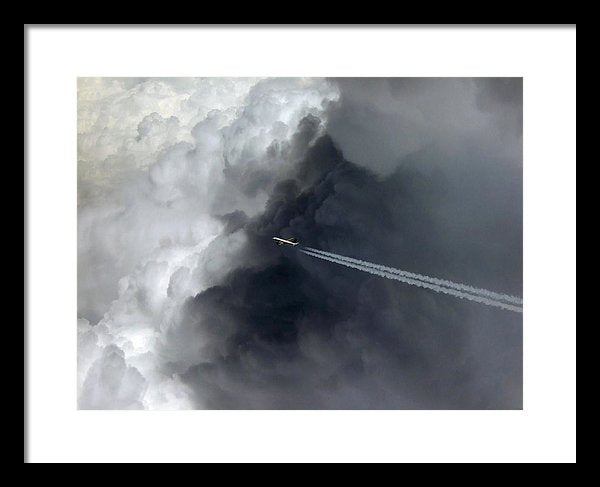 Airplane Flying Above Dark Clouds - Framed Print