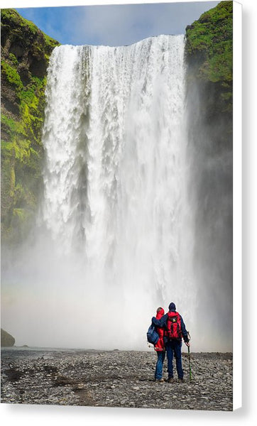 Enjoying Skogafoss Waterfall In Iceland - Canvas Print