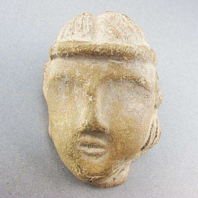 Ancient artifact greco roman fragment head