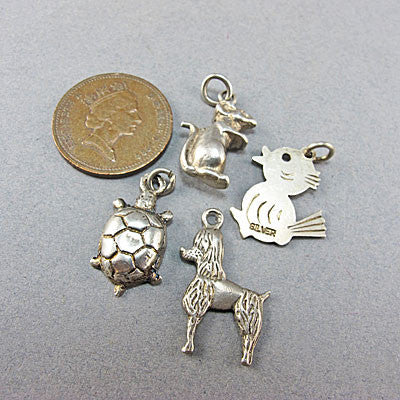4 Vintage silver  jewellery charms