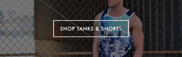 Button to shop men's sleeveless tank top shirts and athletic board shorts