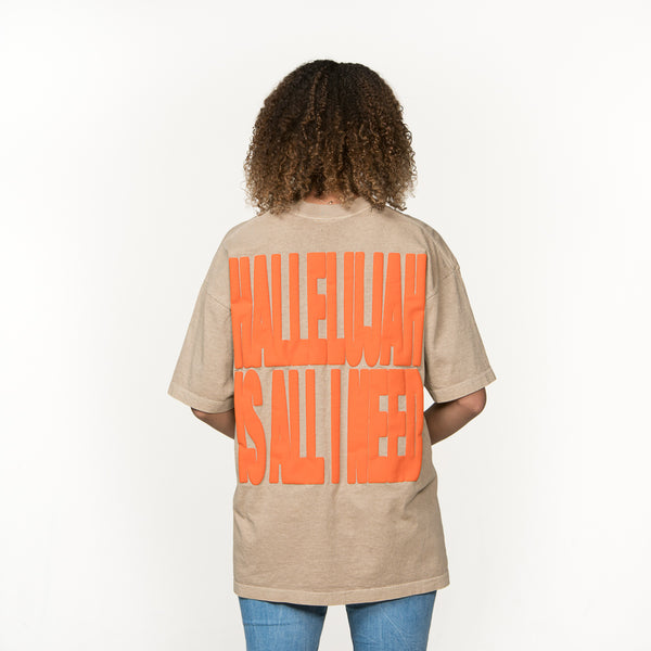Back Facing - African American female with Hallelujah Is All I Need in large orange text on tan shirt