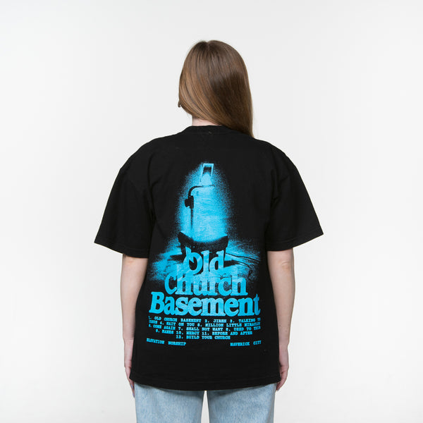 Back Facing - Caucasian female with Elevation Worship Old Church Basement album artwork black shirt with blue print