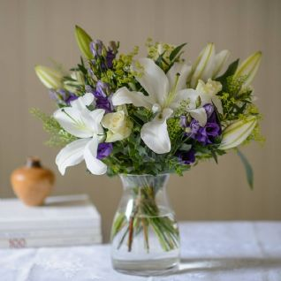 Axford - Blue Freesia, White Lily Bouquet.