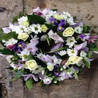 Funeral Wreath in Lilac and Cream Flowers.