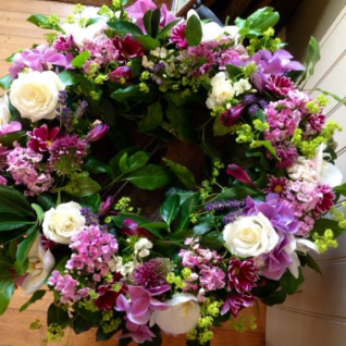 Funeral Wreath in Lilac and Strong Pink Flowers.