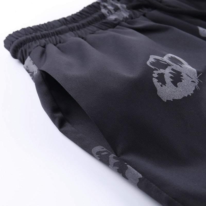 'Social Butterfly' reflective sweatpants