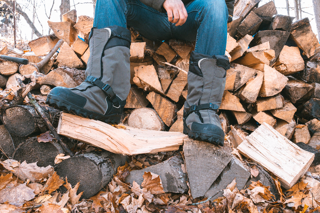 wearing overshoes wood pile cutting wood