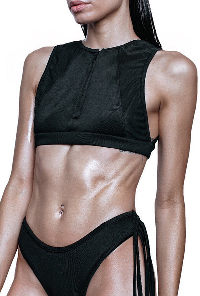 left side of black swim crop top with zipper in front