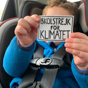 child holding Greta Thunberg school strike for the climate protest poster sticker