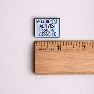 'we'll be less activist if you'll be less shit' protest poster pin with ruler for scale