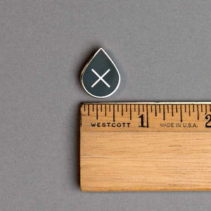 leave it in the ground enamel lapel pin with ruler for scale