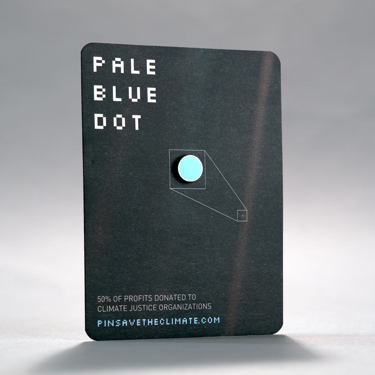carl sagan inspired pale blue dot enamel lapel pin on backing card