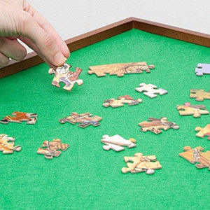 Jigsaw puzzle board with cardboard puzzle pieces.