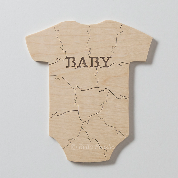 wooden jigsaw puzzle guestbook for baby shower shaped like baby garment with word BABY on chest