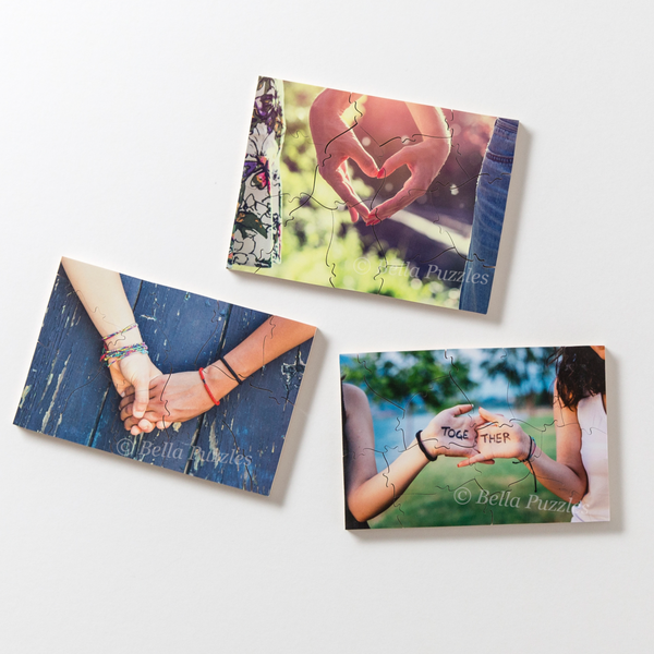 Three gift-sized custom wooden photo puzzles showing people holding hands. You can use puzzles custom made with your own similar images for bridesmaid gifts, birthday presents, weddings, or the holidays. Made by BELLA PUZZLES.