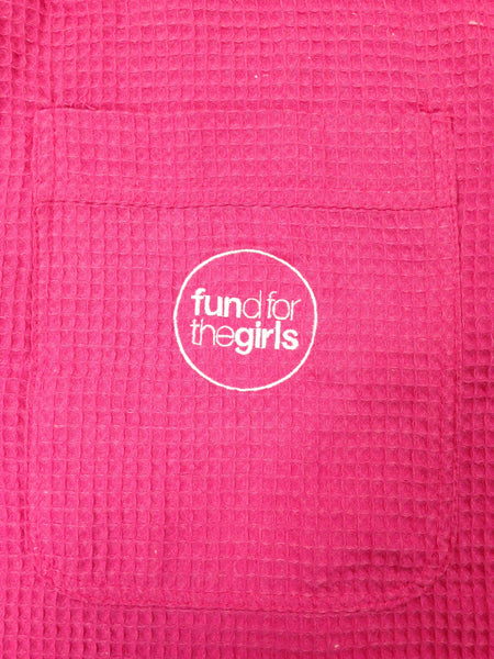 Detail of fund for the girls logo on pocket of Pink Waffle Robe