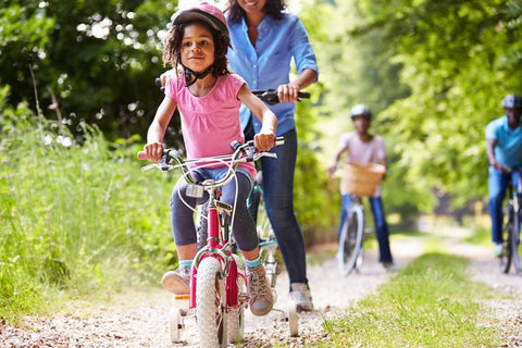 Family biking in the park - exercise reduces stress
