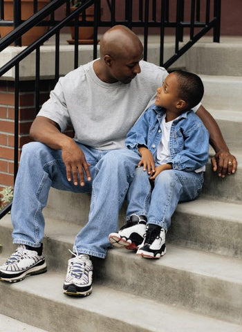 Father and son talking on a bench to ease stress and anxiety