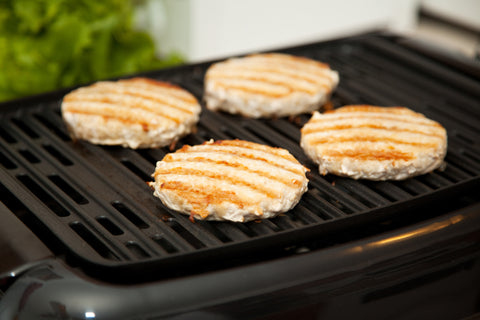 Turkey burgers on a grill