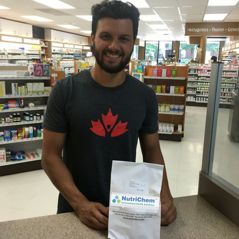 Michael Tayler - picking up his NutriChem custom vitamin