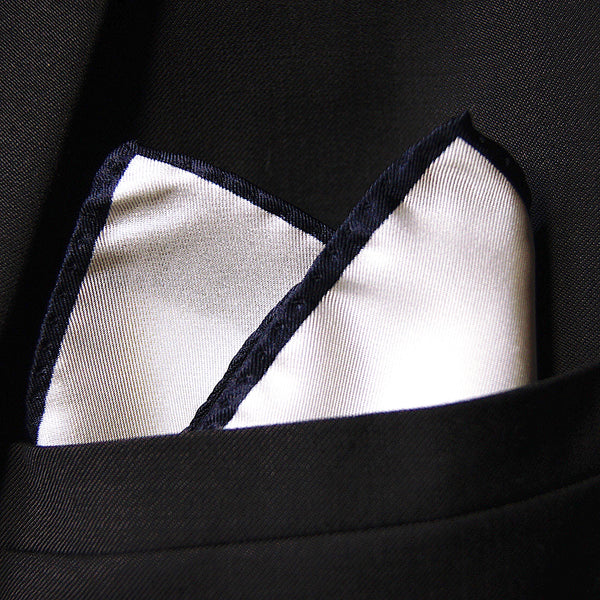 White silk pocket square with navy blue border
