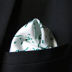 Silk pocket square with green faces pattern