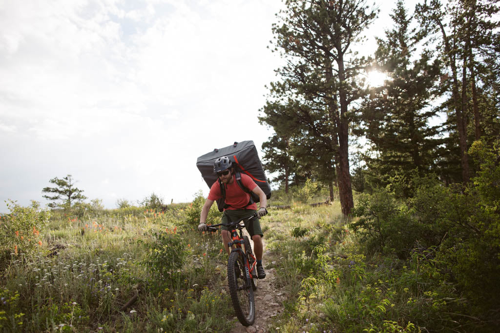 Mountain biking with Oru Kayak