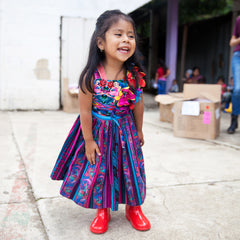 roma foundation guatemala girl in red rain boots