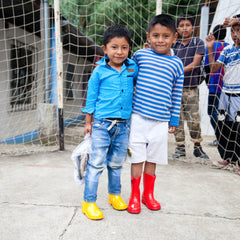roma foundation guatemala boys in colorful rain boots