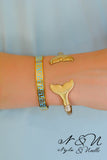 A TALE TO TELL - Gold Tone Whale Tail Adjustable Cuff by Nyla and Noelle