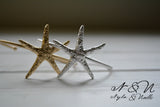 A STAR IS BORN -  Gold Tone Starfish Cuff by Nyla and Noelle
