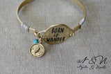 BORN TO WANDER - Antique Gold Tone Bangle by Nyla and Noelle