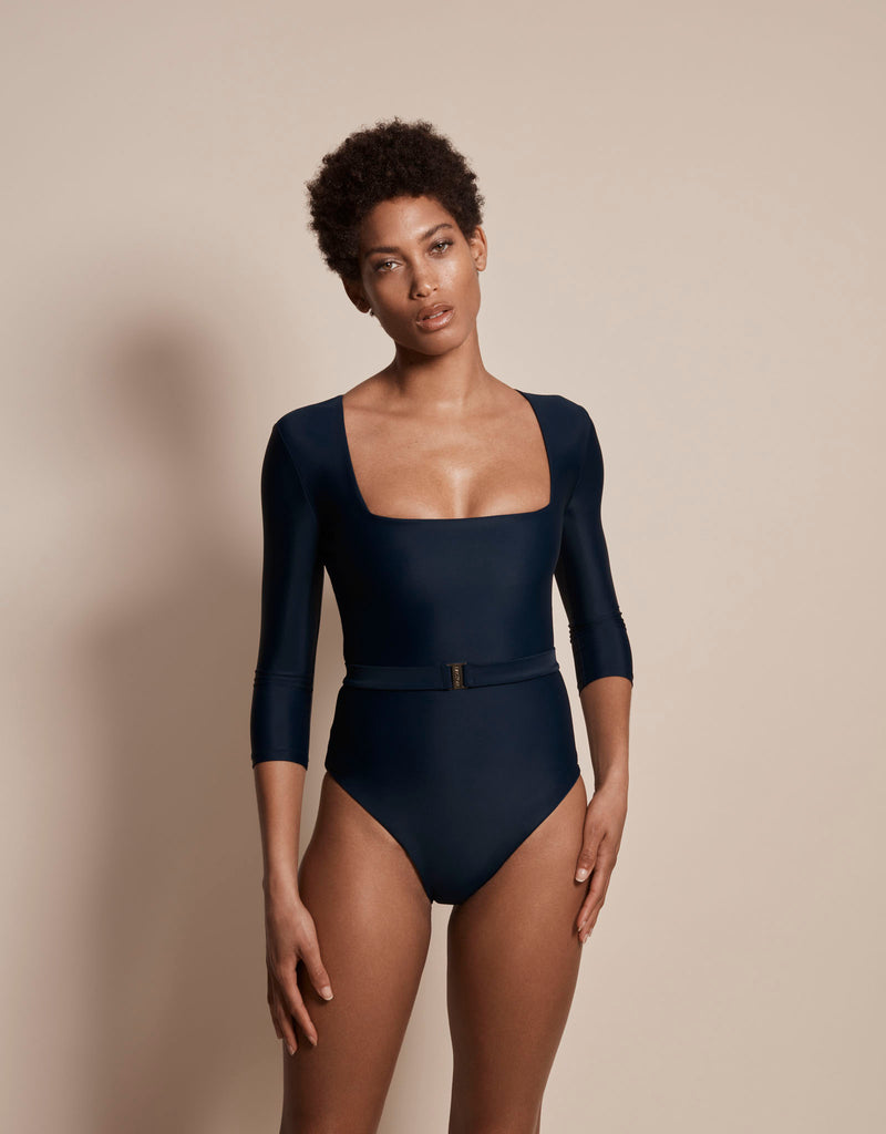 Luxury long sleeve sun protective sustainable swimsuit in blue