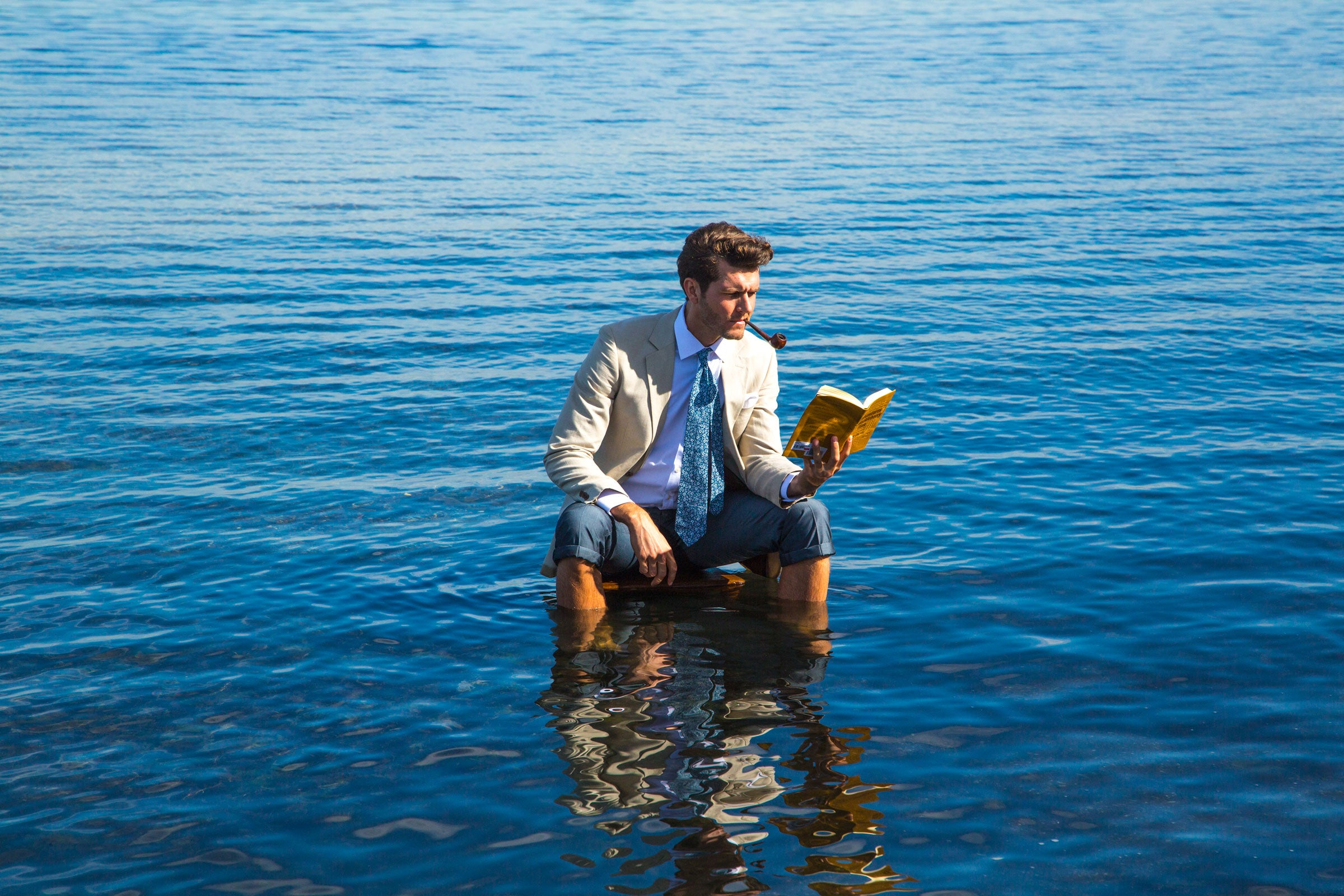 Suits in Water OTAA reading a book