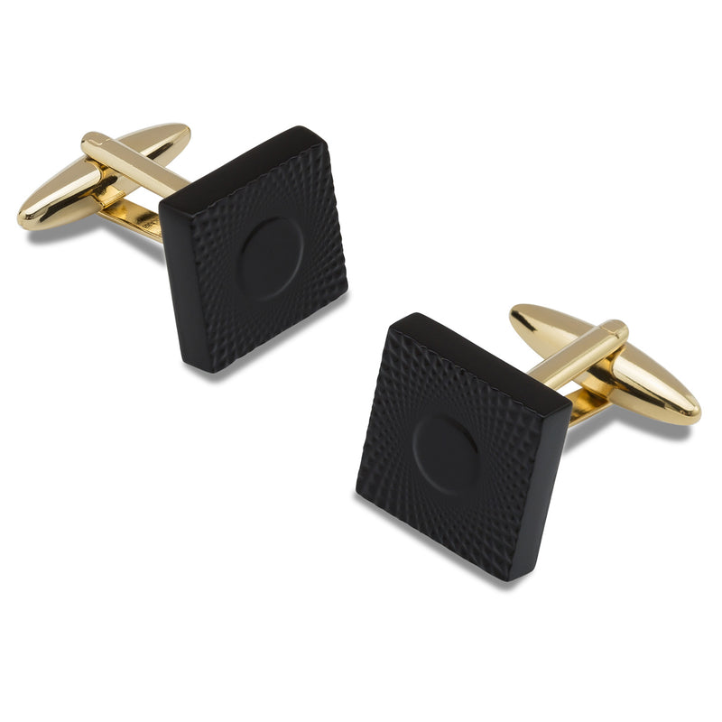 Black and gold colour cufflinks.