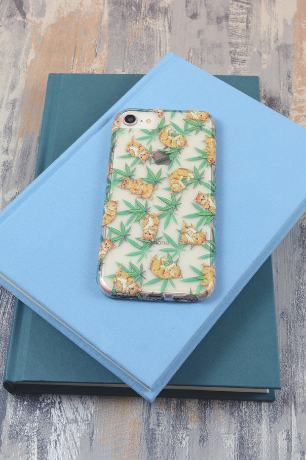Lightly Toasted Cat and Leaf Print iPhone Case on top of books