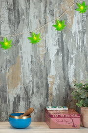 Lightly Toasted Leaf String Lights hanging from a wall