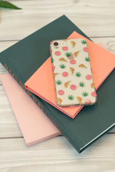 Lightly Toasted Pizza Print iPhone Case on top of books