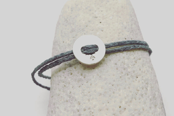 Silver button (12mm) against grey linen waxed cord