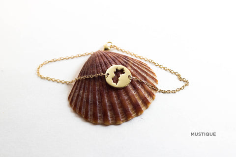 Mini (12mm)10K gold medallion with matching bracelet and Mustique border.