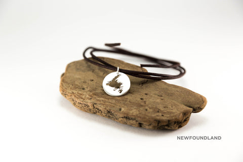 Large medallion (app. 20mm) necklace shown in sterling silver with matte finish, leather cord and Newfoundland border.