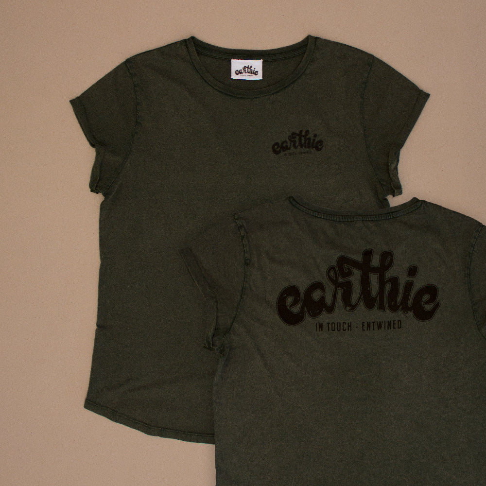 Two Womens Rolled Sleeve Tee in Stone Wash Green grouped together, one showing the front of the garment with a small black Earthie logo printed on the front left chest position, the other showing the back of the shirt which has a large black Earthie logo printed across the shoulders.